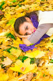 Pretty caucasian girl in autumn forest Stock Photos