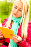 Pretty caucasian girl with book Stock Images