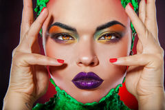 Pretty caucasian girl with creative multicolored makeup Stock Images