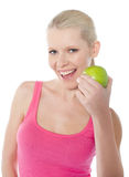 Pretty caucasian girl eating an apple. Young caucasian girl holding green apple isolated on white background Royalty Free Stock Photos