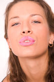 Pretty caucasian girl making a kiss Stock Photos