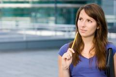Pretty caucasian girl pondering or thinking