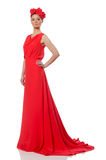 Pretty caucasian model in red long evening dress isolated on whi Stock Photography