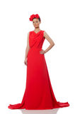 Pretty caucasian model in red long evening dress isolated on whi Royalty Free Stock Photo