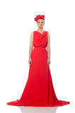 Pretty caucasian model in red long evening dress isolated on whi Royalty Free Stock Image
