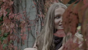 Pretty caucasian woman in autumn park enjoying nature. stock video footage