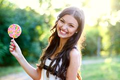 Pretty caucasian woman with bright funny lollipop Stock Photography