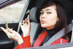 Pretty caucasian woman in a car Stock Photography