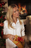 Pretty Caucasian woman in Christmas interior Stock Images