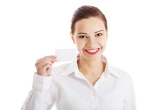 Pretty caucasian woman holding a white card Royalty Free Stock Image
