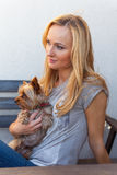 A pretty caucasian woman at home sitting on the porch with dog Royalty Free Stock Photo