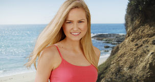 Pretty caucasian woman smiling on a sunny day at the beach Stock Image