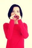 Pretty caucasian woman whispering gossip. Stock Images