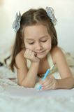 Pretty Caucasian young girl with a pencils Royalty Free Stock Image