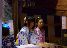 Pretty charm sellers at Gion Matsturi festival in Kyoto Japan Royalty Free Stock Photo