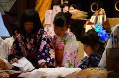 Pretty charm sellers at Gion Matsturi festival in Kyoto Japan Stock Image