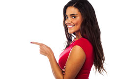 Pretty charming girl pointing away Royalty Free Stock Photography