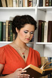 Pretty charming lady holding books Stock Images