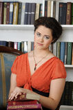 Pretty charming lady holding books Royalty Free Stock Image