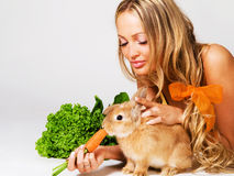 Pretty Cheerful Girl Feeding A Rabbit Stock Images