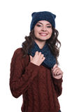 Pretty cheerful young woman wearing knitted sweater, scarf and hat. Isolated on white background. She is smiling. Royalty Free Stock Photo