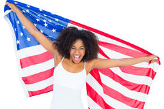 Pretty cheering girl in white top holding american flag Stock Photo