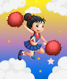 A pretty cheerleader with her red pompoms Stock Photos
