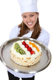 Pretty Chef Holding Cake Royalty Free Stock Photos