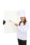 Pretty Chef Holding Menu. A pretty woman chef holding a menu isolated over white royalty free stock photos