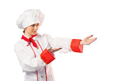 Pretty chef presenting with hands Royalty Free Stock Photo