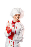 Pretty chef showing thumbs up Royalty Free Stock Image