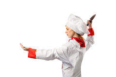 Pretty chef slicing with knife Stock Images