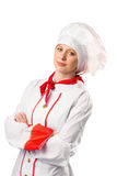 Pretty chef standing with arms crossed Stock Photo