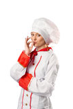Pretty chef standing with arms crossed Royalty Free Stock Photography