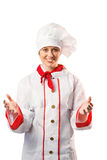 Pretty chef standing with hands out. On white background stock image