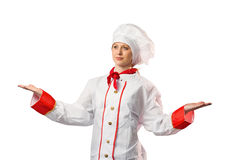 Pretty chef standing with hands out Stock Image