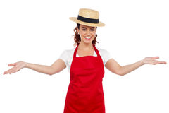 Pretty chef welcoming you with her arms stretched. Isolated over white background Royalty Free Stock Image
