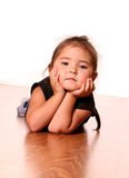 Pretty Child. Beautiful & Cute little Girl laying on the Floor stock photography