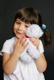 Pretty Child. Precocious little girl hugs her favourite plush toy Stock Photos