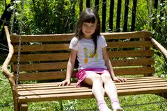 Pretty Child On Bench Royalty Free Stock Photography