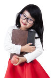 Pretty child with book and apple Royalty Free Stock Image