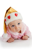 Pretty child in christmas hat Royalty Free Stock Image