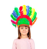 Pretty child with colorful indian feathers Stock Photos