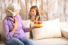 Pretty child congratulating granny with event royalty free stock photography