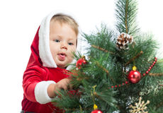 Pretty child decorating Christmas tree Stock Photo