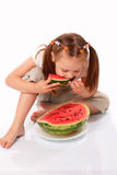 Pretty child eating watermelon Stock Images