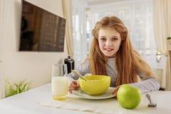 Pretty child enjoying healthy food Royalty Free Stock Photos