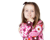 Pretty child with finger over lips. Isolated on white background Stock Photo