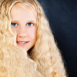 Pretty Child Girl on Blue Background. Long Blonde Hair Stock Photos