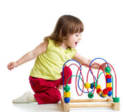Pretty child girl with color educational toy Royalty Free Stock Image
